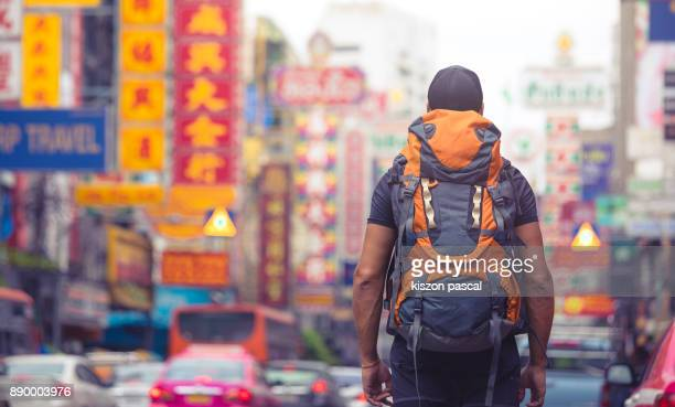 backpacker traveling alone in asia . .