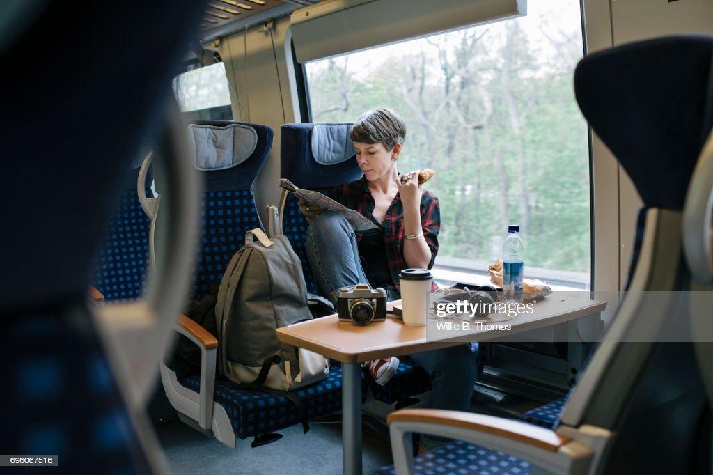Backpacker Traveling On Train : Stock Photo