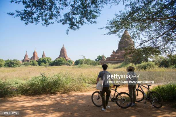 Backpacker traveling with backpack and looks at Buddhist stupas. Myanmar