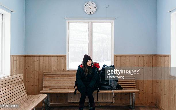 Backpacker waiting in snowy train station