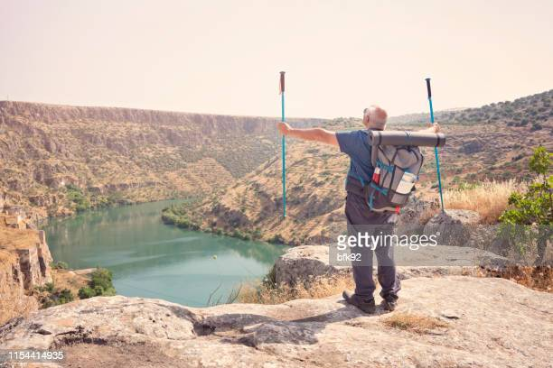 backpacker watching rumkale on top of mountain in gaziantep in turkey country. - national landmark stock pictures, royalty-free photos & images