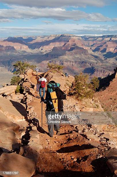 Backpackers approach Cedar Ridge on the South Kaibab Trail, 1.5 miles down from the south rim of the Grand Canyon. From this vista, hikers can enjoy...