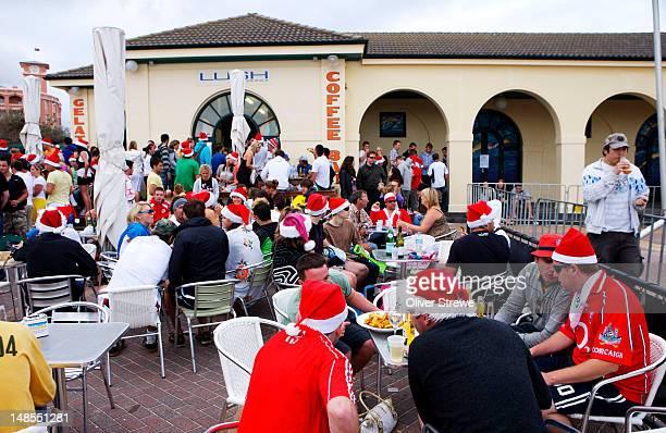 Backpackers celebrating Christmas day, Bondi.