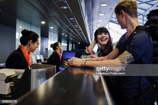 Backpackers Checking-In with Attendant