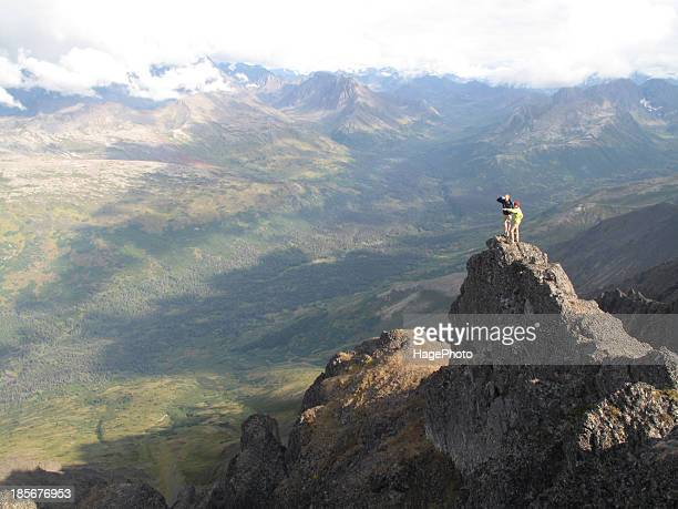backpackers hike in chugach state park near anchorage, alaska. - anchorage alaska stock photos and pictures