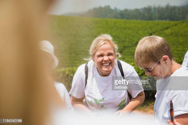backpackers laughing in rural area - vanguardians stock pictures, royalty-free photos & images