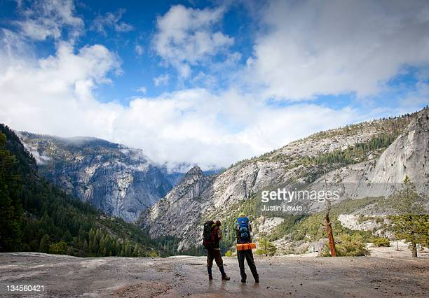 Backpackers looking out at valley in Yosemite