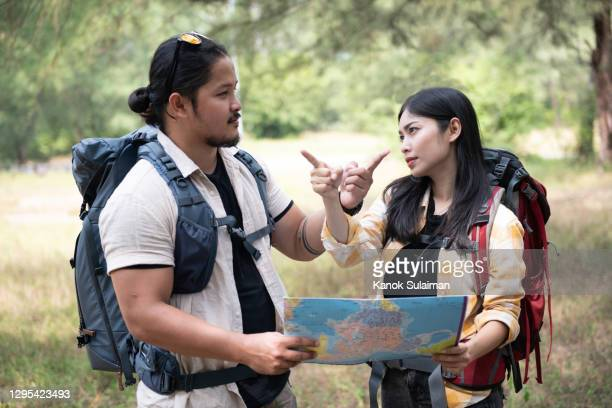backpackers talking and using map - aiming stock pictures, royalty-free photos & images