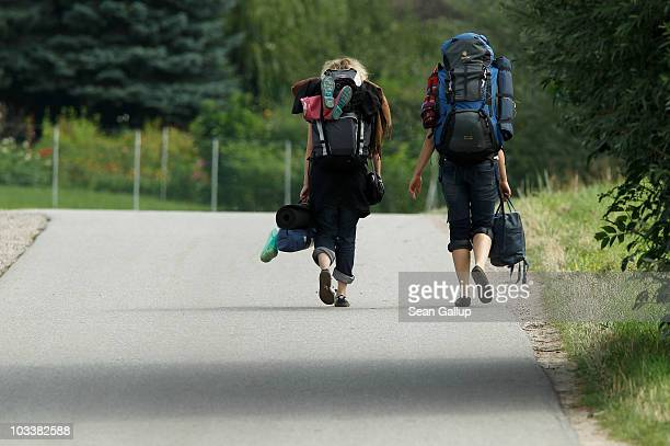 Backpackers walk along a country road on August 13 2010 near Boiensdorf Germany The Baltic Sea coastline with its long sand beaches and rolling...
