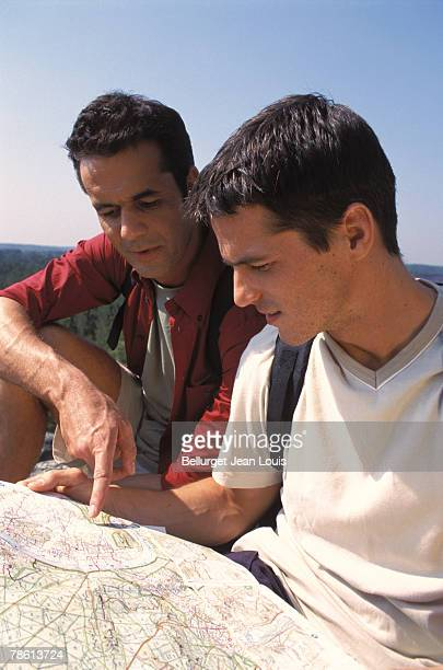 Backpacking friends reading map for directions