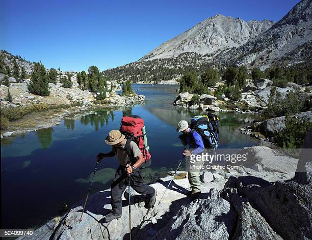 Backpacking Hikers backpack by Rae Lakes along the John Muir Trail in Kings Canyon National Park in California's Sierra Nevada mountains October 1...