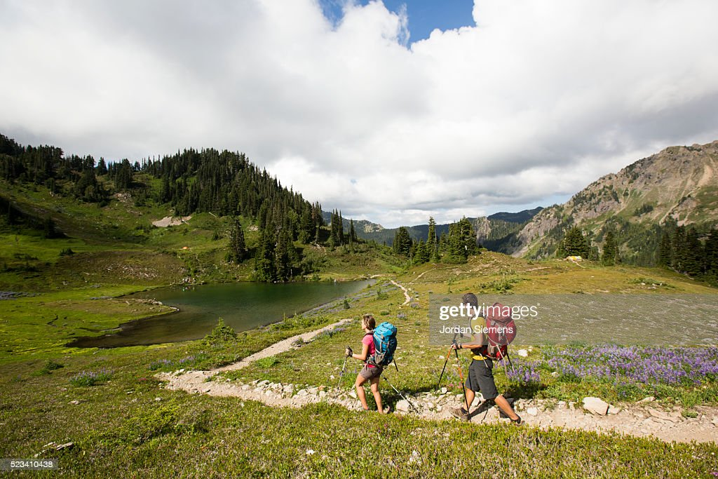 Backpacking in the high mountains : Stock Photo