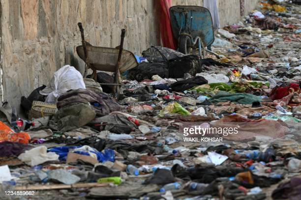 Backpacks and belongings of Afghan people who were waiting to be evacuated are seen at the site of the August 26 twin suicide bombs, which killed...