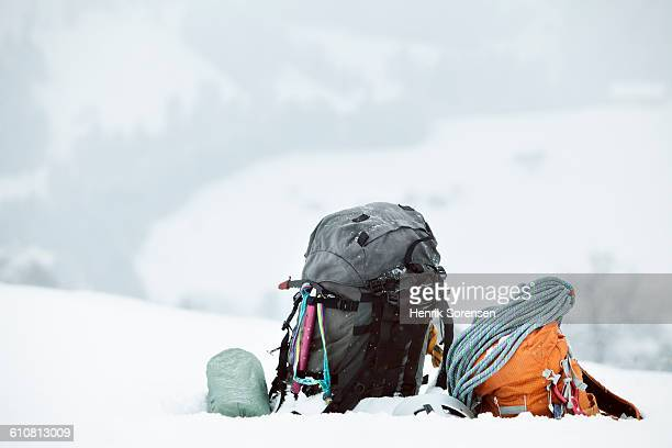 backpacks and rope on mountainside