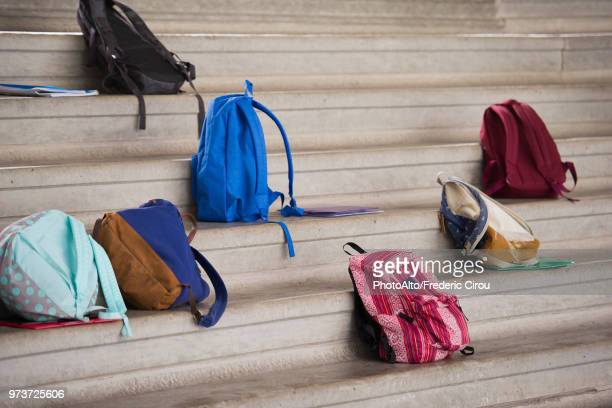 backpacks left on bleachers - rucksack stock pictures, royalty-free photos & images