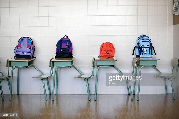 Backpacks on School Desks