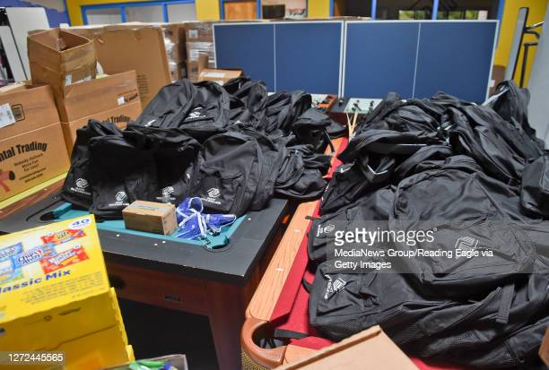 Backpacks with the Olivet Boys and Girls Club logo on them, and other supplies, for students that will participate in the club's program for students...