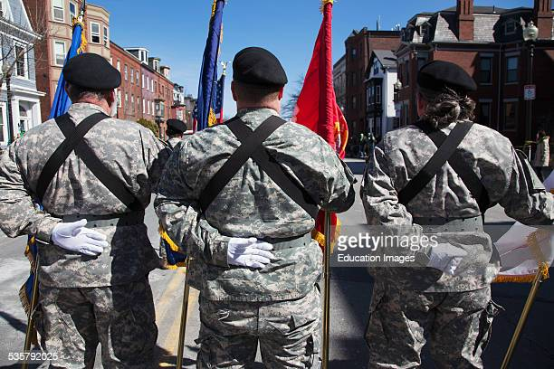 Backs of US Military Honor Guard at ease St Patricks Day Parade South Boston Massachusetts
