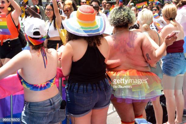 Backs of women at the annual Gay Pride Parade in NYC>