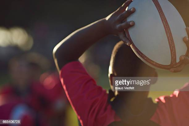 backshot of rugby player throwing ball - amateur stock pictures, royalty-free photos & images
