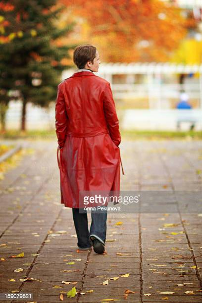 Backside view of woman in red raincoat