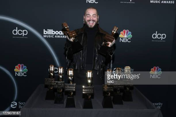 AWARDS Backstage 2020 BBMA at the Dolby Theater Los Angeles California Pictured In this image released on October 14 Post Malone poses with awards at...