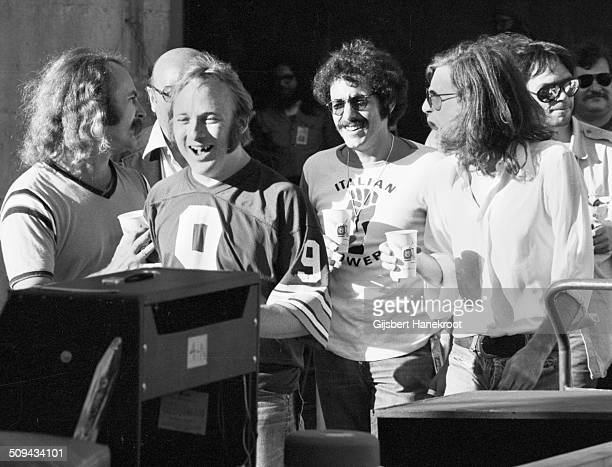 Backstage after a Crosby Stills Nash and Young concert at Oakland Colisseum California on July 14 1974 during their 1974 US Tour LR David Crosby...