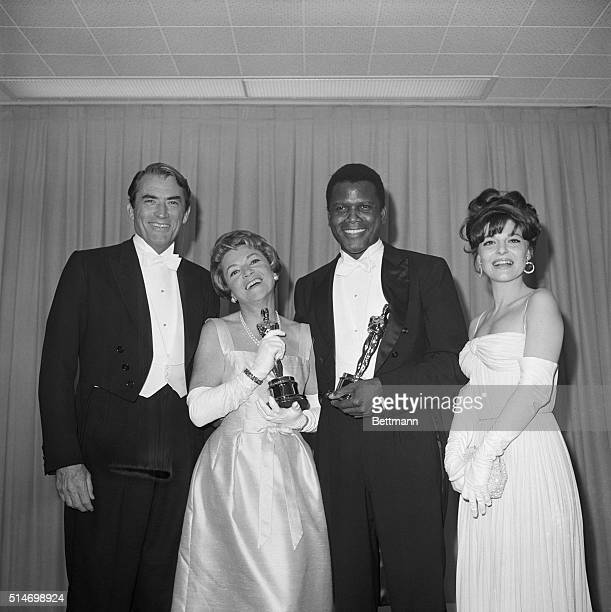 Backstage at the 1964 Academy Awards are Gregory Peck who presented Oscar for Best Performance by an Actress Anabella who accepted the Oscar for...