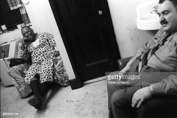 Backstage at the Apollo Theater, American Jazz musician and bandleader Count Basie , in a dressing gown, talks on the telephone, New York, New York,...