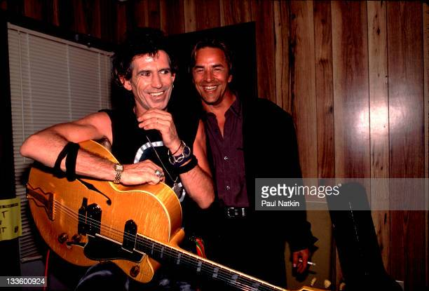 Backstage at the Rolling Stones' 'Steel Wheels' tour British musician Keith Richards of the Rolling Stones poses with American actor Don Johnson late...