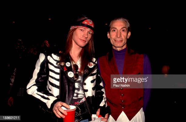 Backstage at the Rolling Stones' 'Steel Wheels' tour British musician Charlie Watts of the Rolling Stones poses with American musician Axl Rose late...