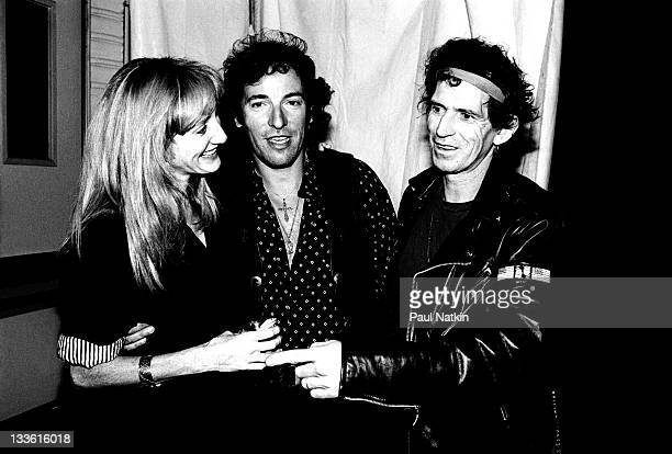 Backstage at the Rolling Stones' 'Steel Wheels' tour British musician Keith Richards of the Rolling Stones poses with American musicans Patti Scialfa...