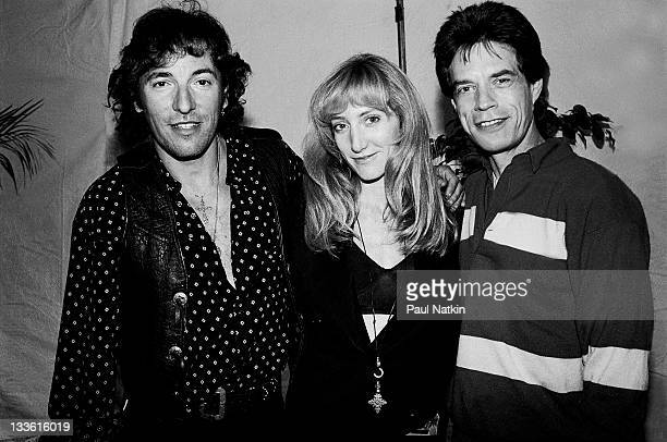 Backstage at the Rolling Stones' 'Steel Wheels' tour British musician Mick Jagger of the Rolling Stones poses with American musicans Bruce...