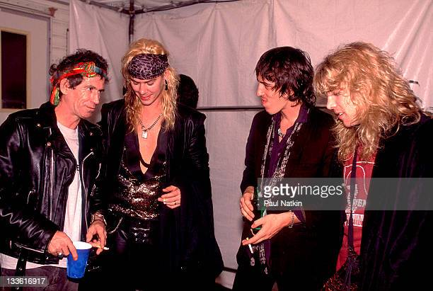 Backstage at the Rolling Stones' 'Steel Wheels' tour British musician Keith Richards of the Rolling Stones talks with American musicians from second...