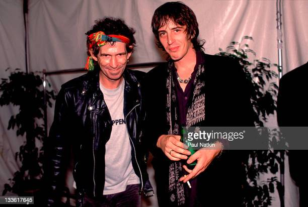 Backstage at the Rolling Stones' 'Steel Wheels' tour British musician Keith Richards of the Rolling Stones poses with American musician Izzy Stradlin...