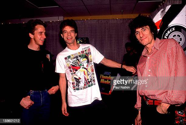 Backstage at the Rolling Stones' 'Steel Wheels' tour British musicians Mick Jagger and Ron Wood of the Rolling Stones poses with American cycling...