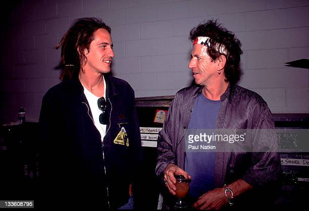 Backstage at the Rolling Stones' 'Voodoo Lounge' tour British musician Keith Richards of the Rolling Stones talks with Izzy Stradlin late 1994