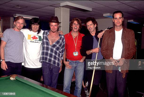 Backstage at the Rolling Stones' 'Voodoo Lounge' tour British musicians Ron Wood and Keith Richards of the Rolling Stones pose with member of the...