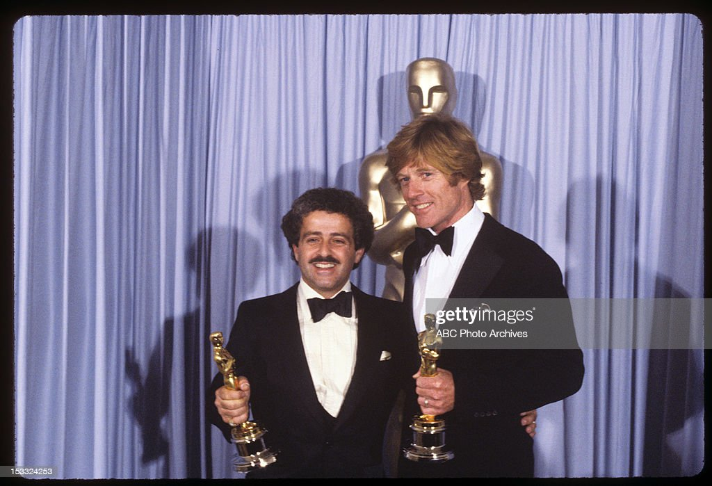 March 31, 1981. PRODUCER RONALD L. SCHWARY (L) AND ROBERT REDFORD WITH BEST PICTURE AND BEST DIRECTOR OSCARS FOR 'ORDINARY PEOPLE'
