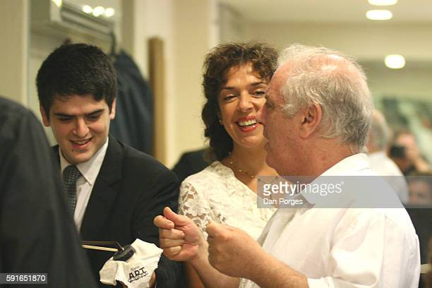 Backstage in a dressing room from left violinist Michael Barenboim shares a smile with his parents married pianists Elena Bashkirova and Daniel...