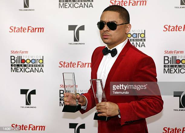 AWARDS 'Backstage' Pictured Larry Hernandez poses backstage with his award for song artist of the year and norteno song of the year during the 2011...