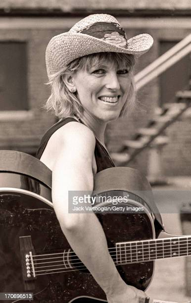 Backstage portrait of American country and folk musician Lucinda Williams prior to a performance at Central Park SummerStage New York New York June...