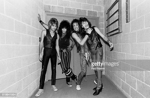 Backstage portrait of American Rock band Quiet Riot at the UIC Pavillion Chicago Illinois November 17 1983 Pictured are from left Carlos Cavazo...