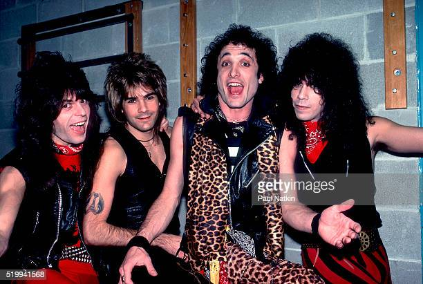 Backstage portrait of American Rock band Quiet Riot at the UIC Pavillion Chicago Illinois November 17 1983 Pictured are from left Rudy Sarzo Carlos...