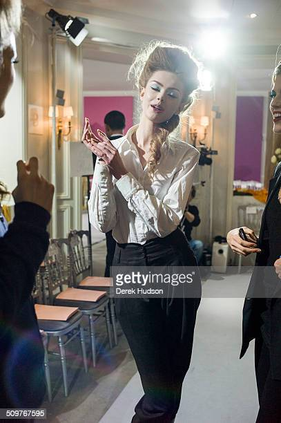 Backstage portrait of an unidentified model as she is prepared for a Christian Dior fashion show Paris France 2010