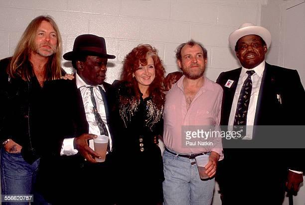 Backstage portrait of from left musicians Greg Allman John Lee Hooker Bonnie Raitt Joe Cocker and Willie Dixon as they pose at Madison Square Garden...