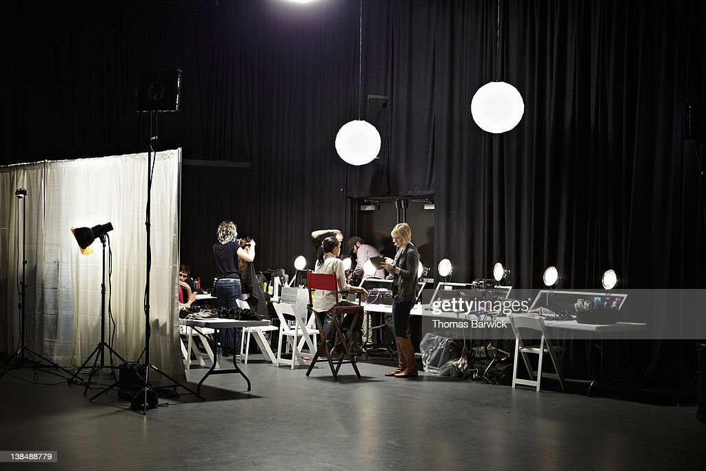 Backstage preparation area of fashion show : Stock Photo