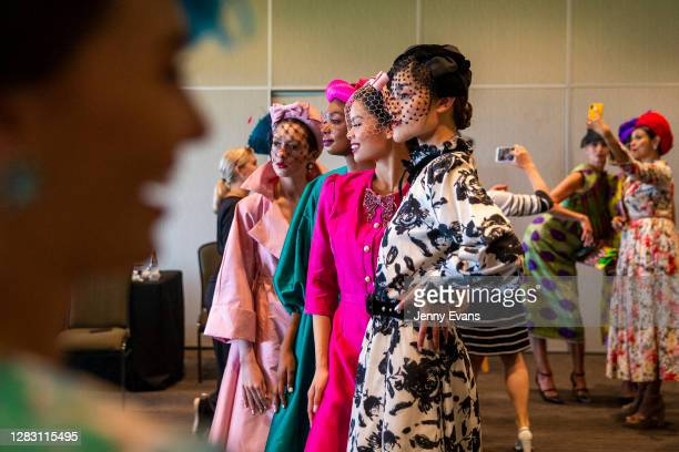 Backstage view is seen of participants in the Fabrics of Multicultural Australia as part of a multicultural spring racewear fashion show during...