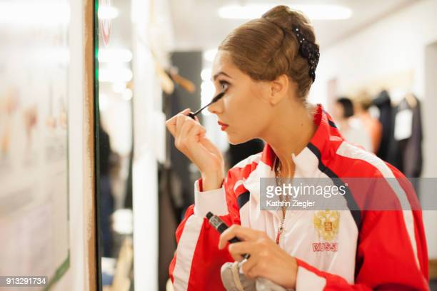 Backstage with the Bavarian State Ballet: Ballerina applying mascara before going on stage