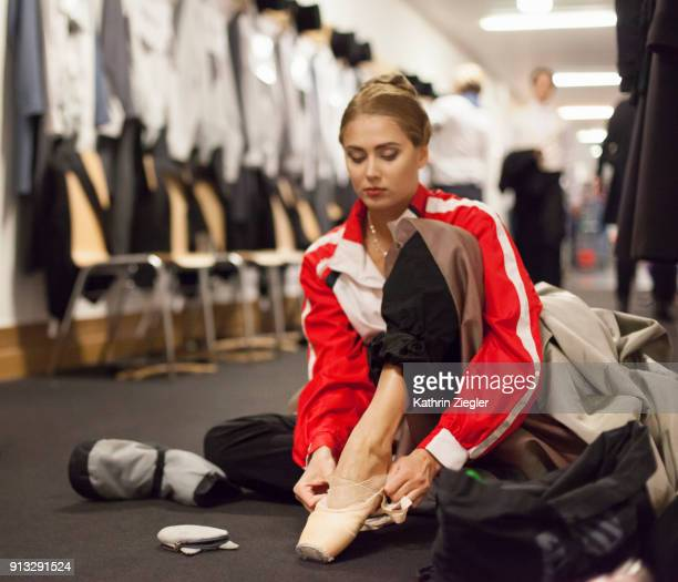 Backstage with the Bavarian State Ballet: Ballerina putting on pointe shoes